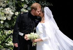 Harry prompted Meghan before the newly-wedded couple shared a kiss on the chapel's steps...