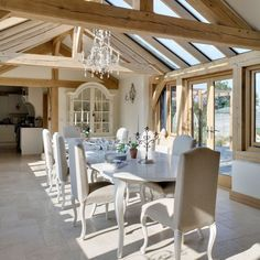 oak framed conservatory - perfect for dining - fabulous French linen chairs - The Paper Mulberry: Essentially French!