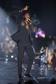 Tinie Tempah wearing Dolce&Gabbana while performing on stage during the TEZENIS Fashion Show. #DGCelebs