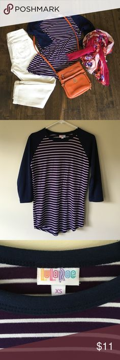 ✨Lowest price✨LuLaroe randy XS striped tee Good condition. Super soft plum purple and navy blue..on the longer side which is good to tuck in or wear with leggings😊 purse is also listed in my closet LuLaRoe Tops Tees - Long Sleeve