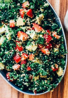 Kale and quinoa provide the perfect, hearty background to fresh summer berries and creamy avocado.