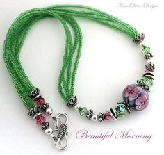 Love how they ended the piece.- lovely inspiration lampwork and seed beads necklace