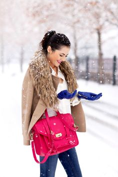 A nicely put together combination of a beige pea coat and blue slim jeans will set you apart effortlessly.  Shop this look for $165:  http://lookastic.com/women/looks/skinny-jeans-satchel-bag-scarf-button-down-blouse-gloves-pea-coat/7045  — Blue Skinny Jeans  — Hot Pink Leather Satchel Bag  — Brown Fur Scarf  — White Button Down Blouse  — Blue Leather Gloves  — Beige Pea Coat
