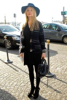 Black and grey jacket + blue hat + black dress, tights and boots