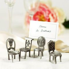 I love these antique chairs as place card holders. Reminds me of the growing in Alice in Wonderland.