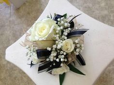Smaller corsage. Like the baby's breath and the ribbon mixed throughout