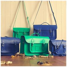 Just a few members of the Emerald and Sapphire family! -- lovely colors by The Cambridge Satchel Company