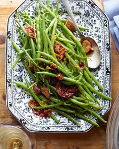 Chances are, you enjoyed a scoop of green bean casserole at Thanksgiving, so try a new, elegant twist for your traditional Christmas dinner side. Roasted chestnuts make a perfectly-fitting (and delicious) addition to these sauteed green beans. #traditionalchristmasdinner #holidaydinnermenu #classicchristmasdinnerideas #familydinner #bhg