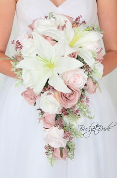 Ballet Pink Davids Bridal Wedding Flowers with ballet pink and blush pink roses, ivory roses, white casablanca lilies in a cascading teardrop bouquet