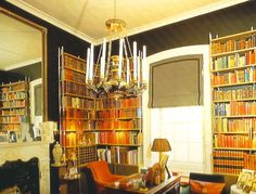 My father's library at Britwell. Color coded books. Predominantly custom bound in red leather.