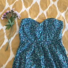 Flower print sundress Turquoise strapless dress with flower print. Sweetheart neckline. 3 beads down front. Perfect condition. Hardly ever worn. Really cute with the crocheted vest listed separately! Willing to bundle them together for a lower price. Kirra Dresses Strapless