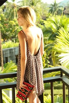 Backless sundress with printed clutch