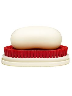 CLYDE   A multi-functional soap dish/brush that stands out in a crowd.