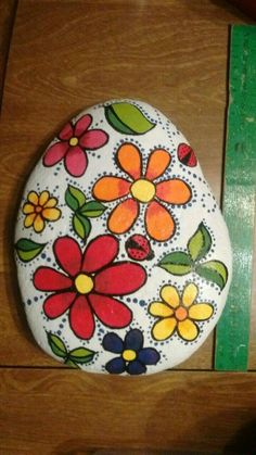 Rock painting flowers with the dots love it