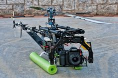 "Aerial Photography with a Trex 700e - DIY Drones ML: Use something smaller and lighter, like ""go pro hero""or similar... anyway, if you learn how to do it smaller, what an amzing survival tool, hã!??"