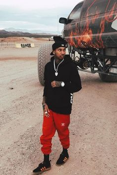 Tyga wearing  Palace Panel Constructed Hood, Adidas Superstar Cuffed Track Pant, Adidas Palace Pro Gum Sole Sneakers