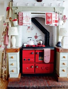 Cute, tiny, retro kitchen in red and white. Love how cozy this looks. 17 Retro Kitchen Designs To Inspire You | Shelterness | (Image only) | Tiny Homes