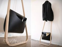 The Servus / r75 Coat Rack by German industrial designer Florian Saul is a modern take on the suit valet. The minimalistic piece consists of a single strip of polished wood that bends slightly forward at the top and bottom to form a practical, yet gorgeous leaning coat rack. The design also incorporates a leather satchel, for any accessories such as gloves, hats, etc.