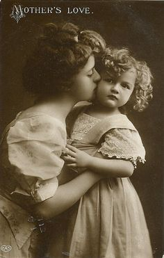 Mother and daughter kiss. So sweet.