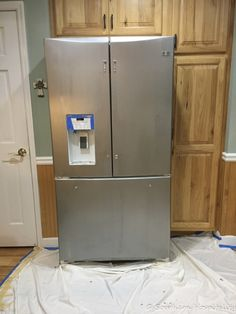 Painting a White Refrigerator with Liquid Stainless Steel - Southern Hospitality Stainless Steel Contact Paper, Stainless Steel Paint, Refrigerator, Fridge Decor, Locker Storage, Stainless Steel Range, Steel, White Refrigerator, Painted Fridge