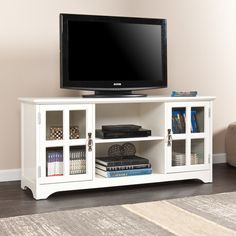 Features:  -Includes 1 open center storage and 2 windowpane cabinets.  -Three adjustable shelves for optimized storage.  -Takes up to a month to complete the off-gassing process.  TV Size Accommodated