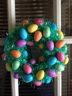 Easter Egg Wreath---add some of that plastic green grass in between the eggs!