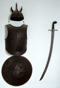 Indo-Persian Devil Mask (kulah khud), cuirass and scimitar.