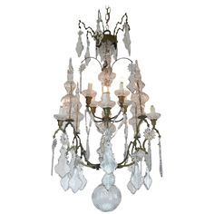 19th Century Italian Crystal and Brass Eight-Armed Chandelier | From a unique collection of antique and modern chandeliers and…