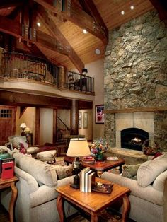 Massive timber trusses and stocky round log posts bring the beauty of wood to the lovely great room. A soaring stone fireplace warms the house on snowy days. My dream home! Cabana, Log Cabin Homes, Log Cabins, Fireplace Design, Cabins In The Woods, My Dream Home, Dream Homes, House Floor Plans, Great Rooms