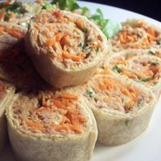 """Chili Tuna Roll-Ups *** Make this for lunch a lot. Changes: I don't cut the rolls up, leave them as a wrap! Use 3T of sweet chili sauce, only 3 green onions, 1/3 less fat cream cheese and only half a package - it's plenty. Needs more than 1T water. Careful which chili sauce you use - some have lots of sugar. Use El Milagro 6"""" tortillas. 6 servings,  160 calories each, 9g protein, 405 mg sodium. *** http://allrecipes.com/recipe/chili-tuna-roll-ups/"""