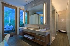 Bathroom Design Idea - Extra Large Sinks Or Trough Sinks Pictures) // The faucets of this long sink are on the ends of it rather than along the back, making the trough sink in this bathroom even more unique. Bathroom Countertop Storage, Storing Towels, Contemporary Barn, Contemporary Furniture, Luxury Furniture, Trough Sink, Steel House, Bathroom Styling, Bathroom Lighting
