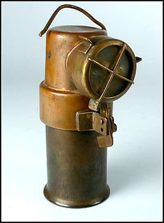 An antique copper miners lantern made in England.