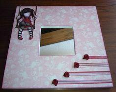 Espejo de malma decorado con papel de scrapbook, Gorjuss en columpio recortada y pegada sobre goma eva y posteiormente añadida a espejo, cintas y flores