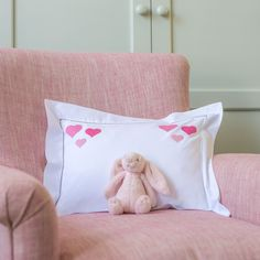 NEW baby pillowcase with a trio of hearts hand embroidered in three shades of pink in each ofthe top corners....