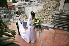 Beauty in the midst of destruction; Haitian bride prepares to enter her wedding ceremony in partially destroyed catholic church in Port-au-Prince.