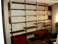 Tension pole shelving/cupboard/divider.