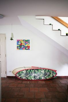 Plenty of room for surfboards under the stairs.