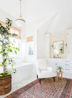 The master bath is a vision in white—with a few metallic accents | archdigest.com