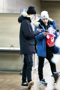 Sehun and Xiumin | 150108 Incheon Airport arriving from London