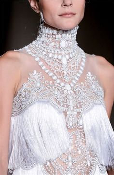 To be Queen - Vogue.  Wonderful catwalk fashion. Beading and Jeweled neckline.  Fringed sheer bodice.