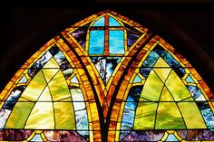 Stained Glass by Dennis Begnoche - Photo taken of stained glass window in church Hanalei Kauai. Click on the image to enlarge.