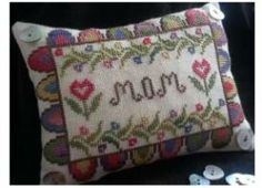 """From Island Cottage Needlearts is this cross stitch pattern titled """"Mom's Penny Pinkeep"""" that will stitchup quickly for a wonderful Mother's..."""