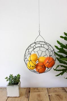 Add color to your kitchen with a sphere of dangling fruits and veggies.