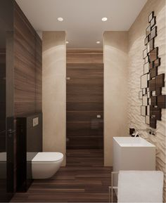 The bathrooms in the home are especially luxurious with their use of glossy wood accents and beautiful stone textures in everything from the his and hers sinks to the beautiful paneling in the shower.