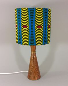 African Ankara vintage lamp with cone-shaped copper base, paired with handmade shade in coordinating ankara fabric. A striking lamp for your home. African Room, African Art, African Style, African Fashion, African Crafts, African Home Decor, African Interior Design, African Design, Antique Lamps