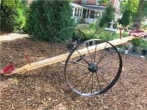 Teeter Totter made from wagon wheels and tractor seats.
