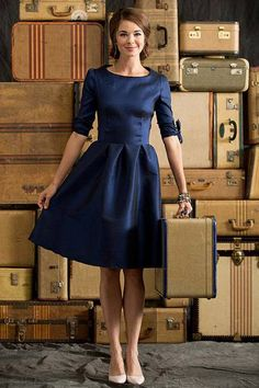 Shop for elegant knee-length dresses in saturated blue hues