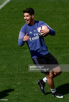 Real Madrid's midfielder Marco Asensio attends a training session at Valdebebas Sport City in Madrid on April 28, 2017 on the eve of their Liga football match against Valencia. /