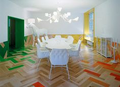 architectural firm tham & videgård hanson; love the design, colored parquet floor