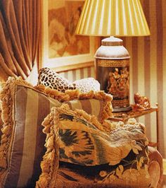 Love the lamp and fabrics....everything just glows.  Cozy style